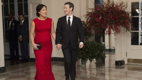 Mark Zuckerberg, Chairman and CEO of Facebook and his wife, Priscilla Chan, arrive for a State Dinner hosted by US President Barack Obama for Chinese President Xi Jinping at the White House in Washington, DC, September 25, 2015. AFP PHOTO /  MOLLY RILEY        (Photo credit should read MOLLY RILEY/AFP/Getty Images)