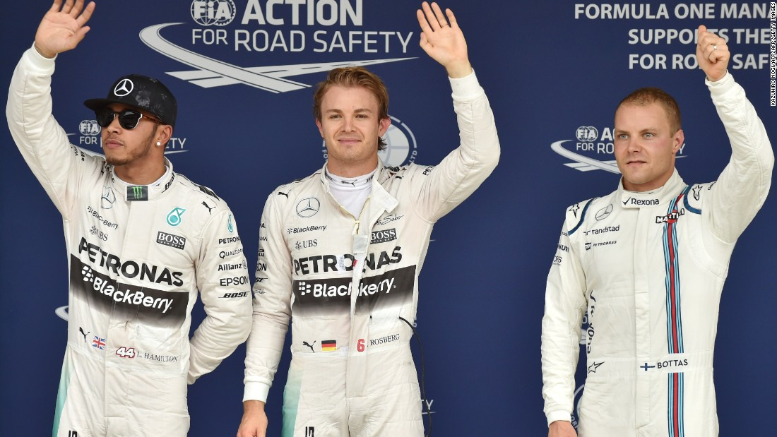 First place Mercedes driver Nico Rosberg of Germany (C), second place Mercedes driver Lewis Hamilton of Britain (L), and third place Williams driver Valtteri Bottas of Finland (R) wave to the crowd after the qualifying session of the Formula One Japanese Grand Prix at the Suzuka circuit.