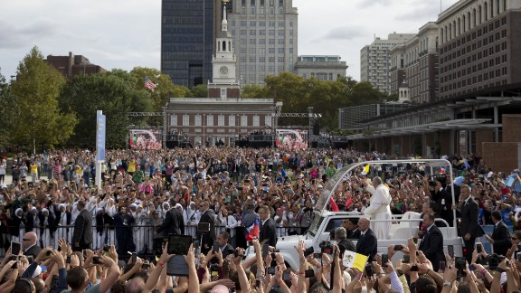 Pope Francis rides in the Popemobile along Independence Mall before delivering a speech outside Independence Hall on September 26.