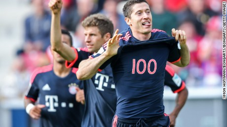 Robert Lewandowski of Muenchen celebrates with team mate Thomas Mueller during the Bundesliga match between Mainz and FC Bayern Munich at the Coface Arena.