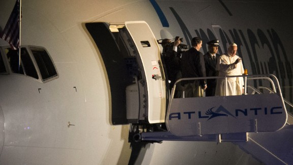 Pope Francis waves from the top of the steps as he prepares to depart Philadelphia International Airport on Sunday, September 27, on his way back to Rome. The Pope has been on a six-day visit to the United States, with stops in Washington, New York and Philadelphia.