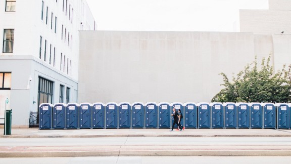 """People pass by a long line of port-a-potties. Philadelphia was prepared for the large crowds days ahead of time. """"It was kind of surreal,"""" Dwyer said."""