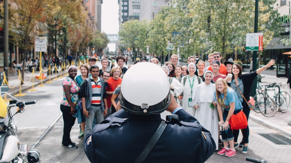 "Dwyer said, ""The Philly police department had such a positive presence at the events. They worked long hours but said that we made it easy on them. This motorcycle officer stopped to take a group photo."""
