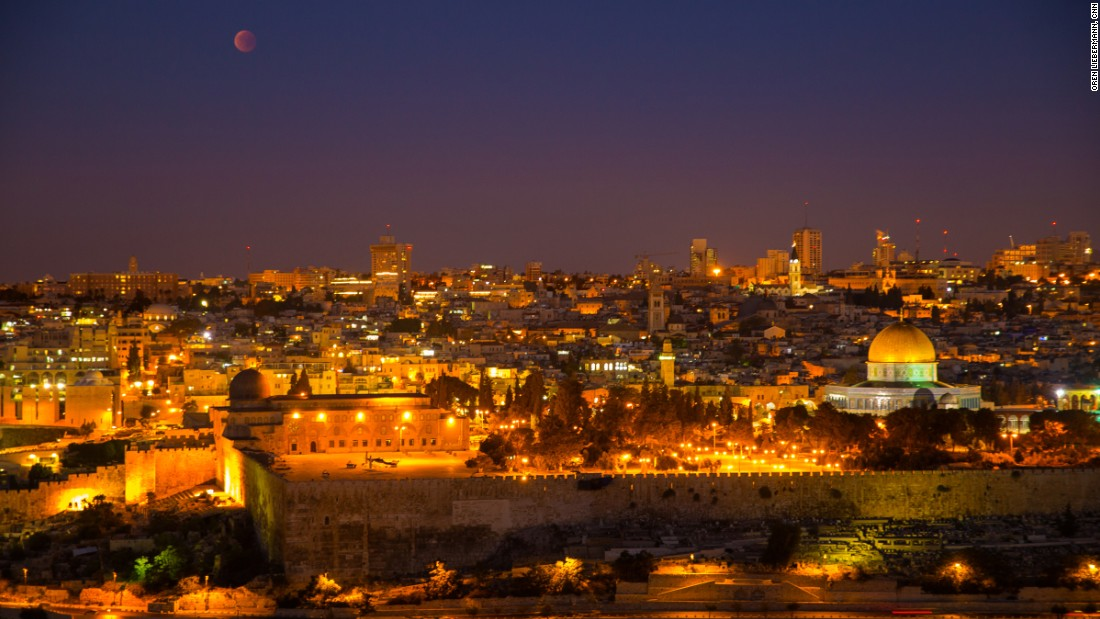 The supermoon eclipse is shown over Jerusalem.