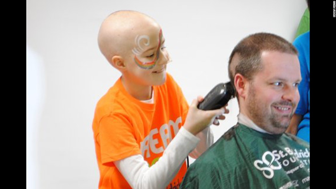"The Dove family became involved with the <a href=""http://www.stbaldricks.org/"" target=""_blank"">St. Baldrick's Foundation</a>, a volunteer organization dedicated to fund-raising for childhood cancer research. In 2014, the Doves attended a local head-shaving event, where Lily was honored and all of them shaved their heads. This year, they participated in another event and their team raised $27,000 for childhood cancer research. Bailey was feeling well that day and even shaved her father's head."