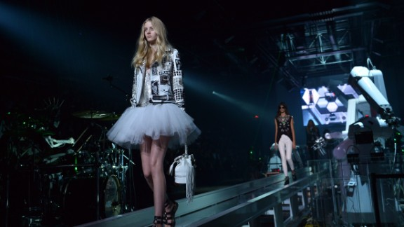 Courtney Love sang at German designer Philipp Plein's show, and the catwalk was surrounded by flying drones, and head-banging robots playing drums and guitar.