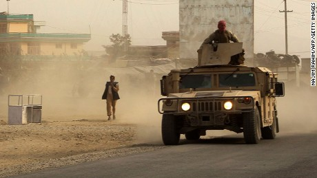 "Afghan security forces travel in a Humvee vehicle, as battles were ongoing between Taliban militants and Afghan security forces, in Kunduz, capital of northeastern Kunduz province on September 28, 2015.  The Taliban are in control of around half of Kunduz, Afghanistan's fifth largest city, a senior police official said September 28.  Sayed Sarwar Hussaini, police spokesman for the northeastern Kunduz province, told a news conference: ""Around half the city has fallen into the hands of Taliban insurgents.""  AFP PHOTO / Najim RahimNAJIM RAHIM/AFP/Getty Images"
