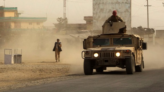 """Afghan security forces travel in a Humvee vehicle, as battles were ongoing between Taliban militants and Afghan security forces, in Kunduz, capital of northeastern Kunduz province on September 28, 2015.  The Taliban are in control of around half of Kunduz, Afghanistan's fifth largest city, a senior police official said September 28.  Sayed Sarwar Hussaini, police spokesman for the northeastern Kunduz province, told a news conference: """"Around half the city has fallen into the hands of Taliban insurgents.""""  AFP PHOTO / Najim RahimNAJIM RAHIM/AFP/Getty Images"""