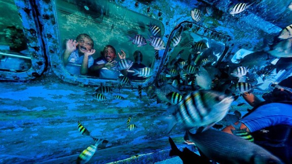 Tourists enjoy Grand Cayman