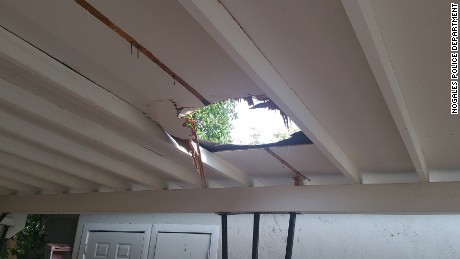 The marijuana bundle tore a hole in the family's carport roof.
