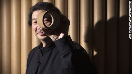 Japanese architect Shigeru Ban poses on March 25, 2014 in his office in Paris. Ban who uses cardboard tubes to make temporary housing for victims of natural disasters and refugees fleeing violence, has won his field's highest honour, the Pritzker Architecture Prize.  AFP PHOTO / JOEL SAGET        (Photo credit should read JOEL SAGET/AFP/Getty Images)