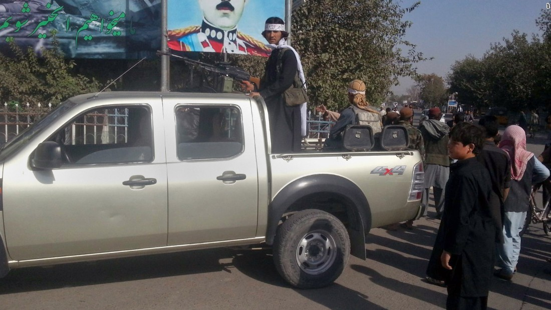 A Taliban fighter stands guard on a vehicle in Kunduz on September 29.