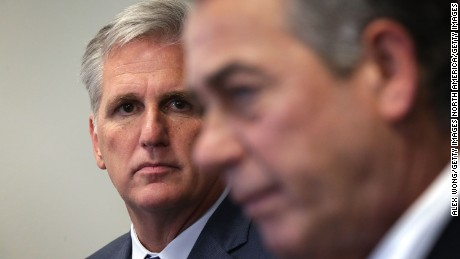 U.S House Majority Leader Rep. Kevin McCarthy (R-CA) (L) listens as Speaker of the House Rep. John Boehner (R-OH) (R) speaks to member of the media after a House Republican Conference meeting September 29, 2015 at the U.S. Capitol in Washington, D.C.
