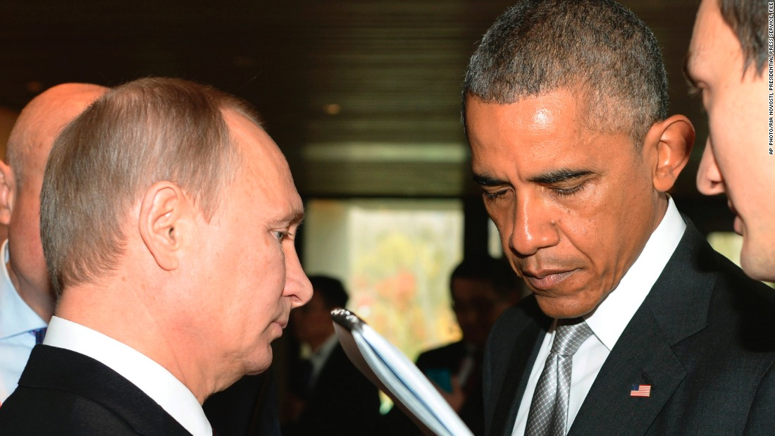 Putin speaks with Obama during the Asia-Pacific Economic Cooperation summit in Beijing, China on November 11, 2014. U.S.-Russia relations have descended to a new low since Russia annexed Crimea in March.
