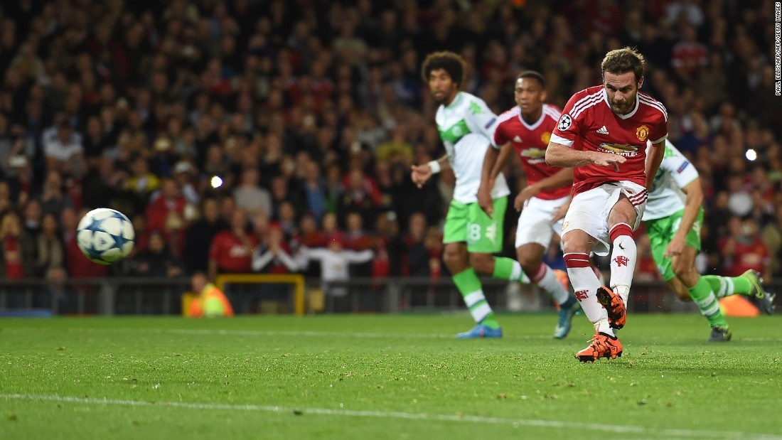 Juan Mata scored a second half penalty and set up the winner for Chris Smalling as Manchester United came from behind to defeat German side Wolfsburg 2-1 at Old Trafford.