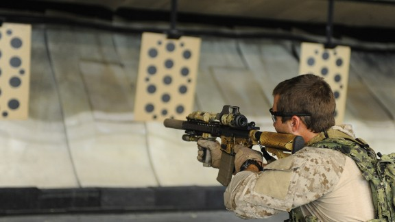 2. They generally have eight years of experience in the conventional military  In this photo, an East Coast-based U.S. Navy SEAL practices shooting drills at the Naval Special Warfare Eagle Haven Indoor Shooting Range on Joint Expeditionary Base Little Creek-Fort Story in 2013.