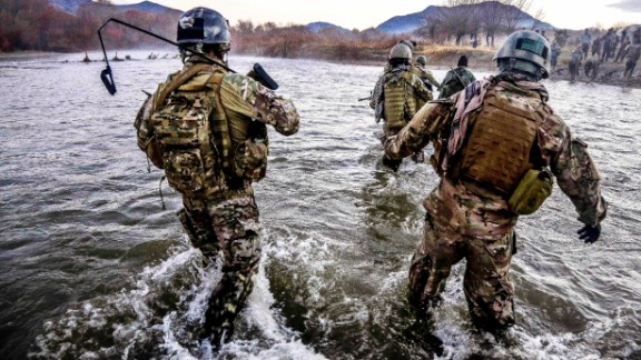 8. They provide aid in humanitarian crises when other forces are not available  In the photo, U.S. Special Forces members cross a wide river during a clearance operation in Zabul province, Afghanistan, in December 2013.