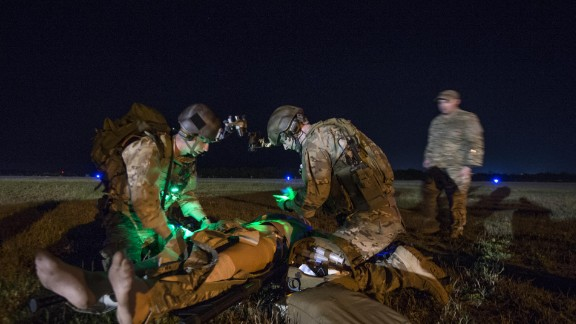 7. Everyone has a certain level of medical training  In this photo, a U.S. Air Force Special Operations medical element team member, 1st Special Operations Support Squadron, and a U.S. Army Special Operations Resuscitation Team member, 528th Sustainment Brigade, examine a patient at Crestview Airfield, Florida, in April 2015.