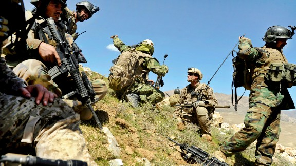 3. They can carry up to 100 pounds of gear in their rucksacks  In this photo, members of the 8th Commando Kandak and coalition Special Operations forces discuss troop movement during a firefight near in Daykundi province, Afghanistan, in 2012.