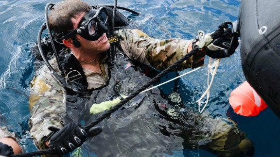 9. They often participate in team sports such as water polo, wrestling or football  Pictured is a U.S. Air Force Combat Control airman from the 320th Special Tactics Squadron, Kadena Air Base, preparing to submerge during an amphibious operations exercise in September 2015 off the  coast of Okinawa, Japan.