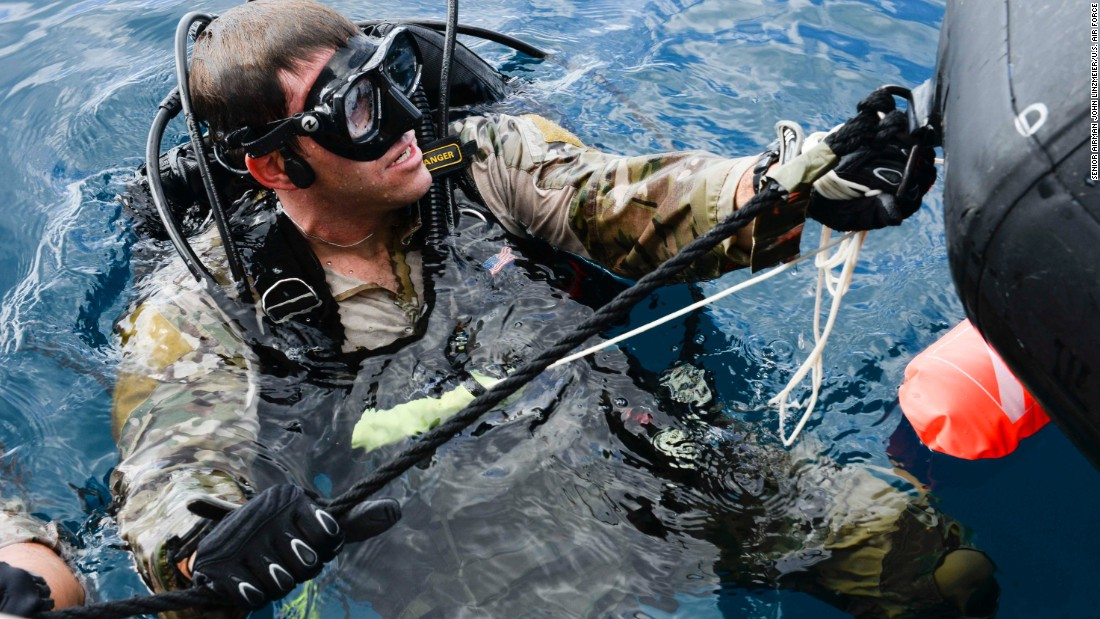<strong>9. They often participate in team sports such as water polo, wrestling or football</strong><br /><br />Pictured is a U.S. Air Force Combat Control airman from the 320th Special Tactics Squadron, Kadena Air Base, preparing to submerge during an amphibious operations exercise in September 2015 off the  coast of Okinawa, Japan.