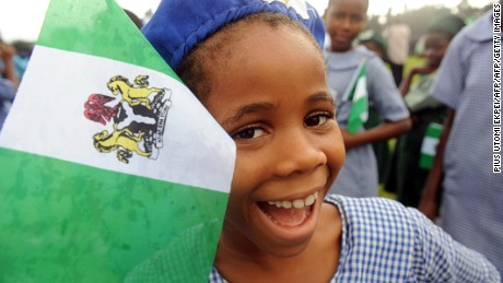 A Nigerian student smiles as she attends independence day celebrations in Lagos in October 1, 2013. Nigeria's president Goodluck Jonathan said he had formed a panel tasked with laying the ground for a national dialogue to tackle contentious issues such as religious tensions and the sharing of oil wealth during an address marking the 53rd anniversary of Nigeria's independence. AFP PHOTO/ PIUS UTOMI EKPEI        (Photo credit should read PIUS UTOMI EKPEI/AFP/Getty Images)