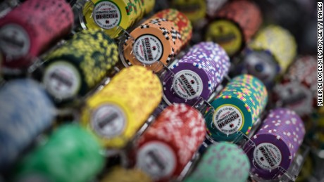 TO GO WITH STORY: Macau-gambling-economy, FOCUS by Laura Mannering and Aaron Tam In this picture taken on May 20, 2015, casino chips are displayed at the Global Gaming Expo Asia in the world's biggest gambling hub of Macau. With casino revenues in Macau plummeting thanks to Beijing's anti-corruption crackdown and a slowdown in the Chinese economy, the gambling hub is seeking to reinvent itself as a family-friendly mass market destination as the high rollers stay away.  AFP PHOTO / Philippe Lopez        (Photo credit should read PHILIPPE LOPEZ/AFP/Getty Images)