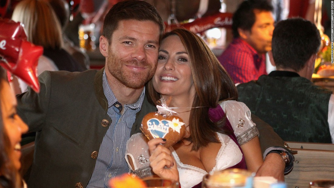 He's won the Champions League with both Liverpool and Real Madrid as well as league titles with the Spanish club and Bayern. The move to Bayern also gave the midfielder the opportunity to expand his wardrobe. The beaming Alonso is pictured with his wife Nagore Aramburo.