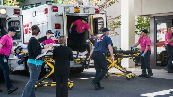 A patient is wheeled into the emergency room at Mercy Medical Center in Roseburg on October 1.