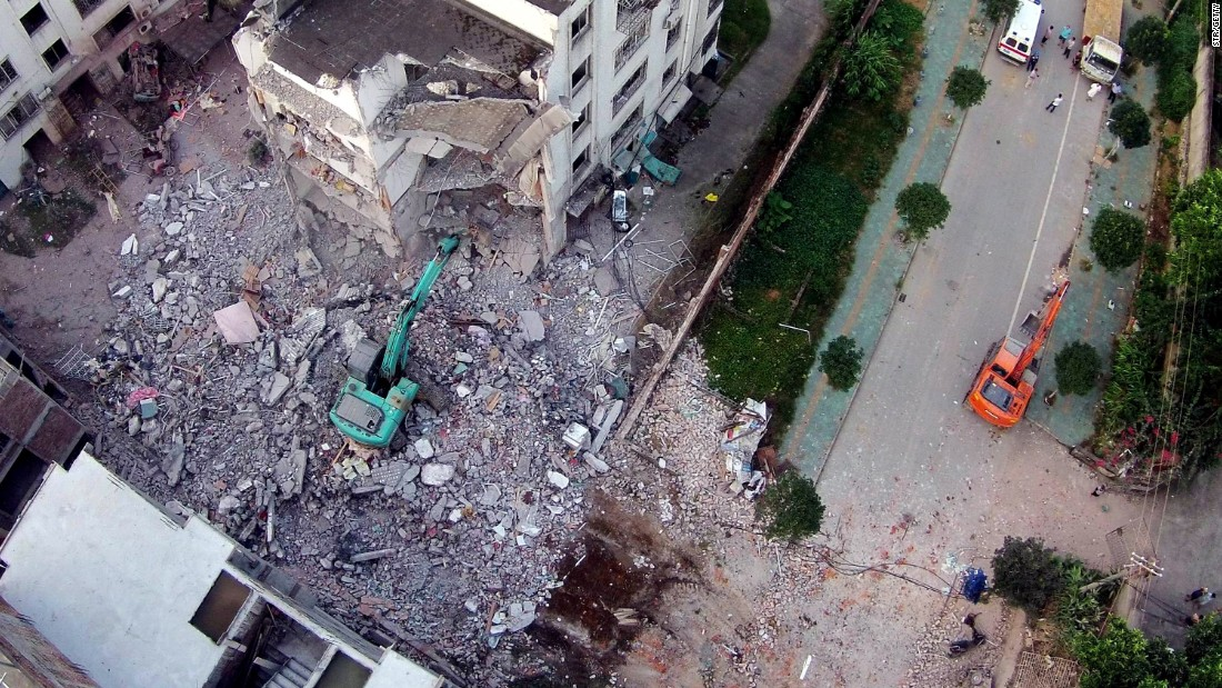 A damaged building is seen a day after a series of blasts in Liucheng county, Liuzhou, in southern China's Guangxi province on October 1, 2015.