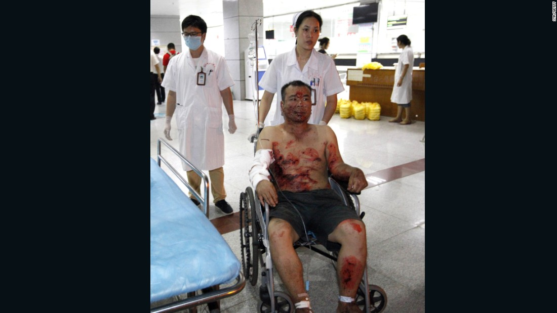 An injured man is given treatment at a hospital.