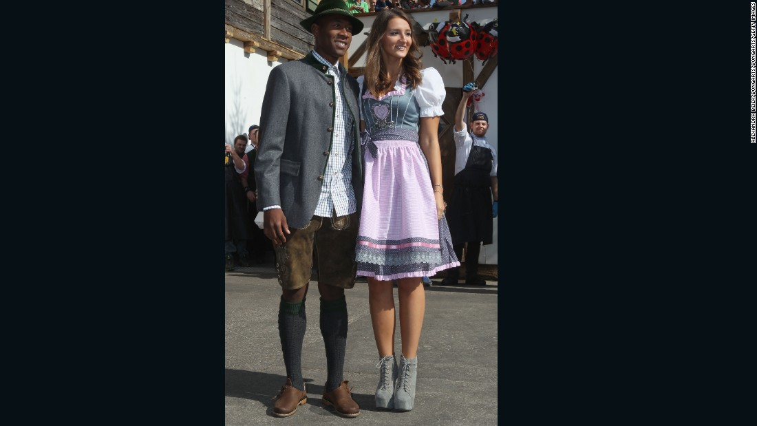 Katja Butylina is pictured with boyfriend David Alaba. Butylina's traditional outfit is offset by an altogether funkier pair of boots.