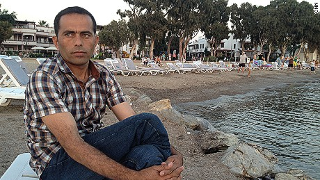 Former Afghan soldier Abdul Wahid Sayeed Khali, known as Wahid, on the beach in Greece, after arriving there by boat from Turkey.