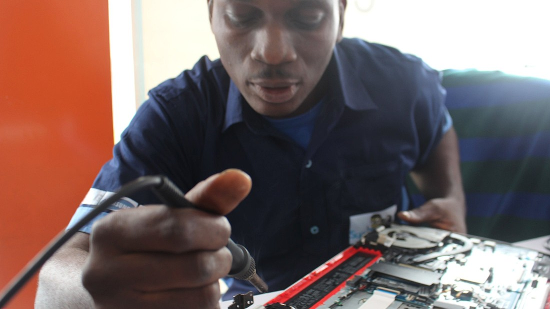 A SuperGeeks employees busy at work on one of the 200 devices the company repairs monthly.