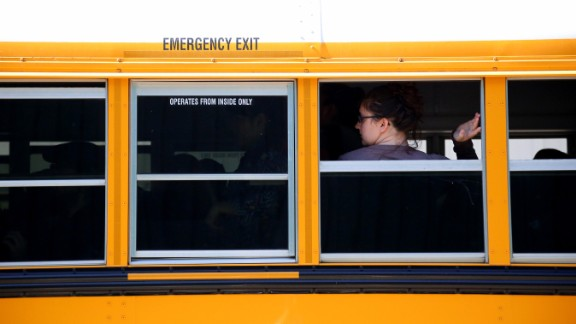 A student waits to walk off a school bus at the fairgrounds on October 1.