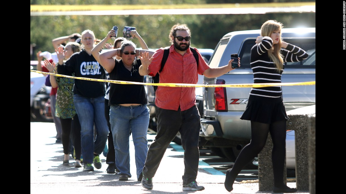 "Students, staff and faculty from <a href=""http://www.cnn.com/2015/10/01/us/oregon-college-shooting/index.html"" target=""_blank"">Umpqua Community College</a> are led away from the school after a deadly shooting Thursday, October 1, in Roseburg, Oregon. Preliminary information indicated that nine people were killed and nine were wounded, police said. Douglas County Sheriff John Hanlin announced at a news conference that the shooter was dead."