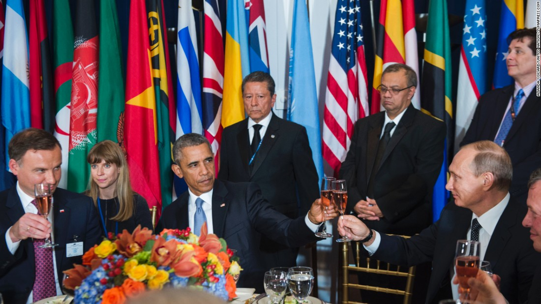 "U.S. President Barack Obama <a href=""http://www.cnn.com/2015/09/28/politics/barack-obama-vladimir-putin-cheers-toast/index.html"" target=""_blank"">shares a toast</a> with Russian President Vladimir Putin at a luncheon in New York hosted by U.N. Secretary-General Ban Ki-moon on Monday, September 28. ""Amid the inevitable trials and setbacks, may we never relax in our pursuit of progress and may we never abandon the pursuit of peace,"" Obama said before clinking glasses. ""Cheers."" The two, bitterly at odds over Ukraine and Syria, <a href=""http://www.cnn.com/2015/09/28/politics/obama-putin-meeting-syria-ukraine/"" target=""_blank"">had a closed-door meeting</a> later in the day.<br />"