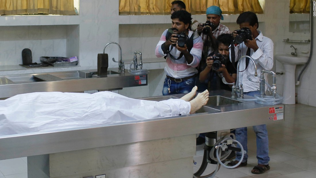 "Journalists take photos of Cesare Tavella, a 51-year-old Italian <a href=""http://www.cnn.com/2015/09/29/asia/bangladesh-isis-italian-killed/"" target=""_blank"">who was gunned down</a> as he jogged home Tuesday, September 29, in Dhaka, Bangladesh. The ISIS militant group claimed responsibility for the killing."