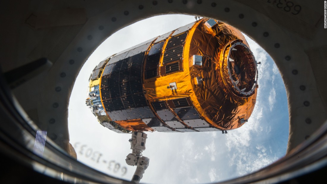 A robotic arm on the International Space Station prepares to release a Japanese cargo vehicle on Monday, September 28. The vehicle had delivered almost 5 tons of hardware and supplies a few weeks ago.