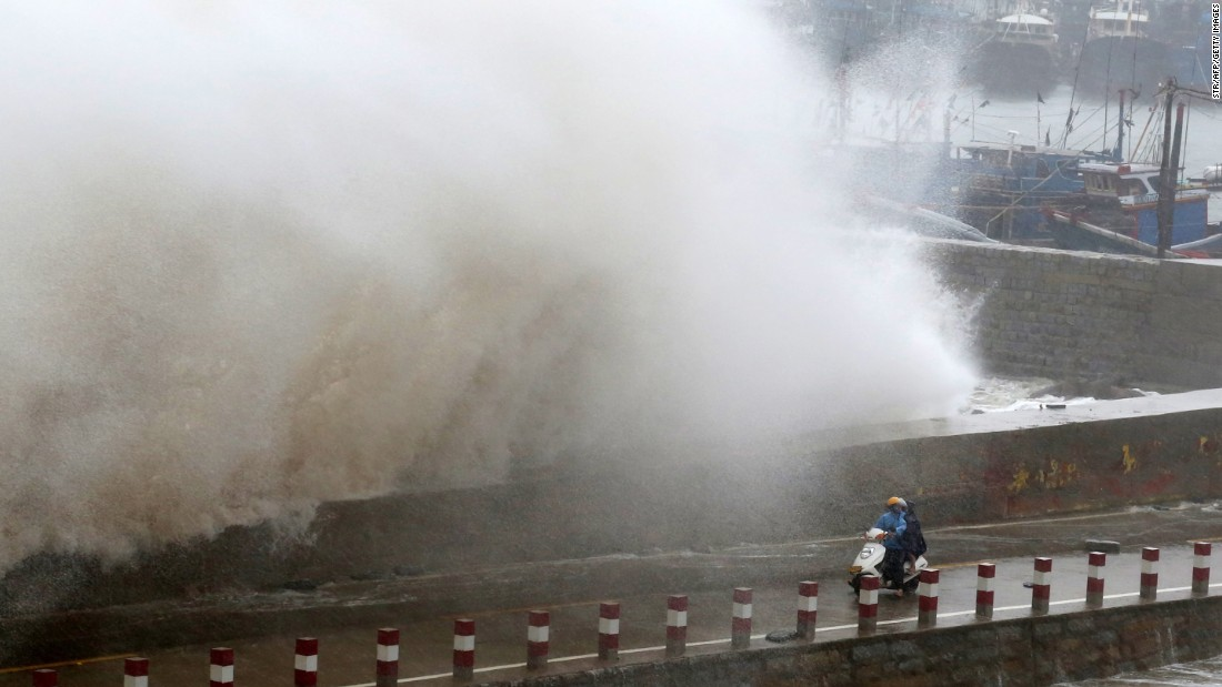"A huge wave crashes over a pier's wall in Quanzhou, China, on Tuesday, September 29. <a href=""http://www.cnn.com/2015/09/29/asia/typhoon-dujuan/"" target=""_blank"">Typhoon Dujuan</a> walloped Taiwan with howling winds and sheets of rain, killing at least two people and injuring more than 300 before heading on to mainland China."