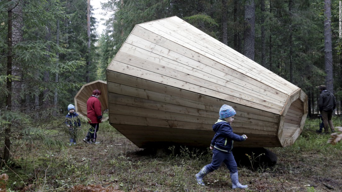 "People gather near wooden megaphones in the forest near the Estonian village of Pahni on Monday, September 28. The megaphones <a href=""http://inhabitat.com/oversized-wooden-megaphones-in-estonia-amplify-the-sounds-of-the-forest/"" target=""_blank"">were set up by architecture students</a> so people could climb inside and listen more closely to the sounds of nature."