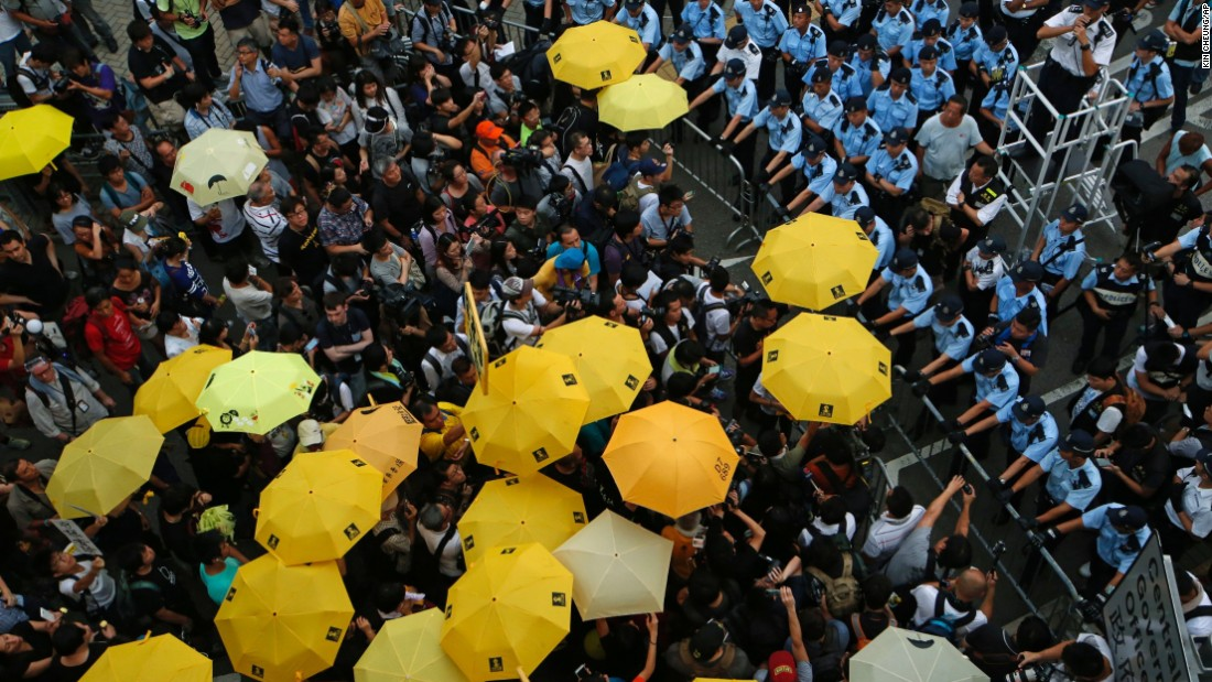 "Protesters holding yellow umbrellas gather for a moment of silence to mark the first anniversary of the ""Umbrella Movement"" in Hong Kong on Monday, September 28. Last year, thousands of protesters <a href=""http://www.cnn.com/2015/09/27/asia/hong-kong-protests-one-year-later/"" target=""_blank"">occupied Hong Kong's financial district</a> to demand true universal suffrage -- one person, one vote, without the interference of Beijing."