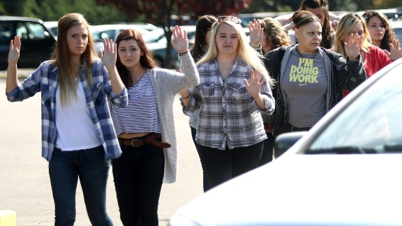 Students, staff and faculty are evacuated from Umpqua Community College in Roseburg, Oregon on October 1, 2015, after a deadly shooting.