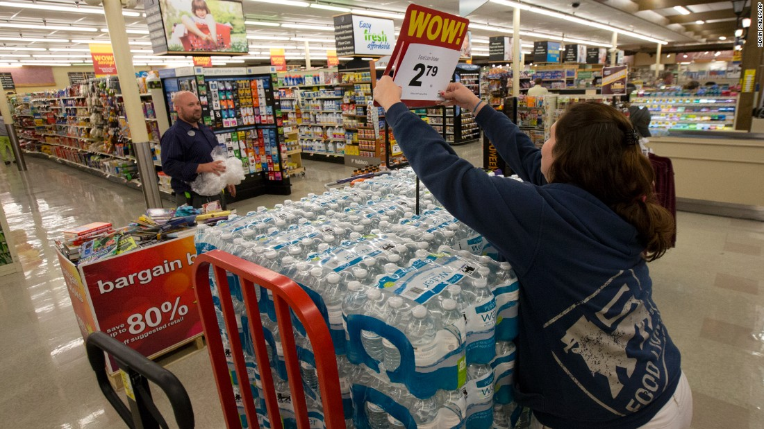 A supermarket worker in Newport News, Virginia, readies cases of bottled water on October 1.