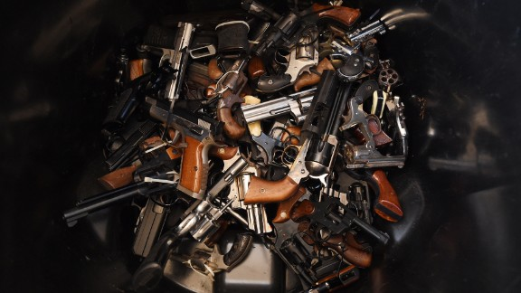Handguns that were swapped for gift cards during a Los Angeles Police Department sponsored gun buyback event in Los Angeles, California on December 13, 2014.  The city held the event in three locations and the public were able safely and anonymously surrender firearms in exchange for $100 and $200 gift cards.    AFP PHOTO/MARK RALSTON        (Photo credit should read MARK RALSTON/AFP/Getty Images)