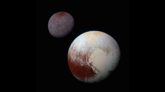 This composite of enhanced color images shows the striking differences between Pluto, lower right, and its largest moon, Charon. NASA says the color and brightness of the two worlds have been processed identically to allow for direct comparison. Pluto and Charon are shown with approximately correct relative sizes, but their true separation is not to scale.