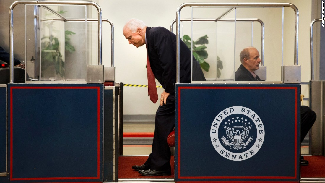 U.S. Sen. John McCain gets on the U.S. Capitol's subway system Wednesday, September 30, in Washington.