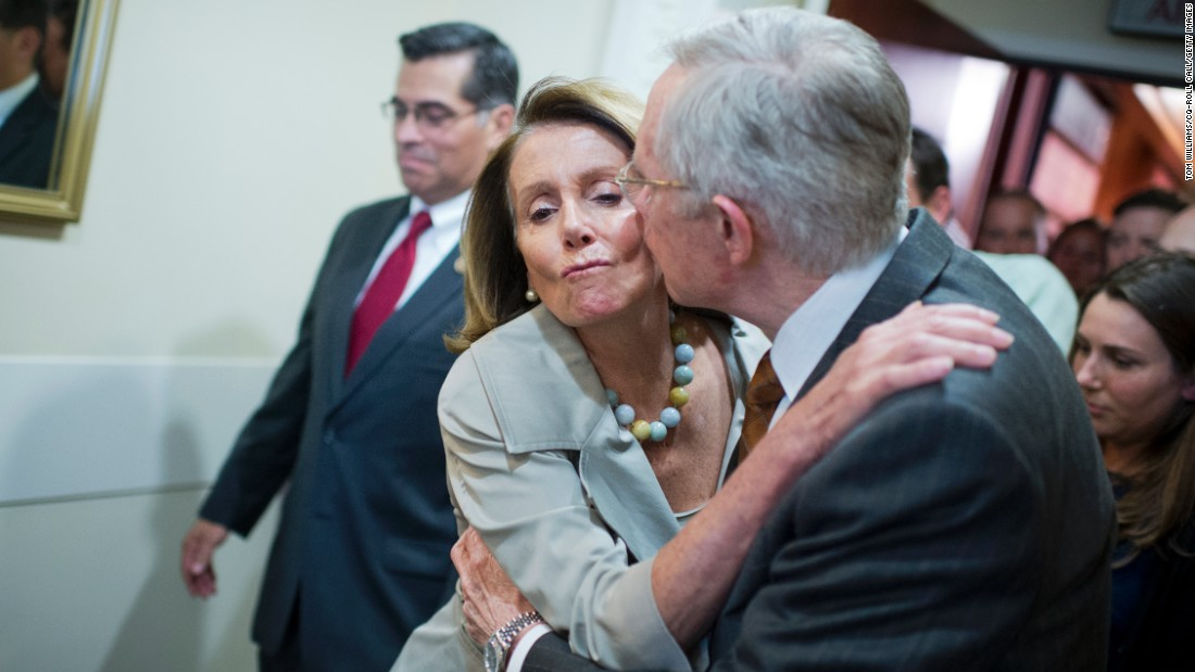 Senate Minority Leader Harry Reid kisses House Minority Leader Nancy Pelosi after a news conference about budget negotiations on Thursday, October 1.