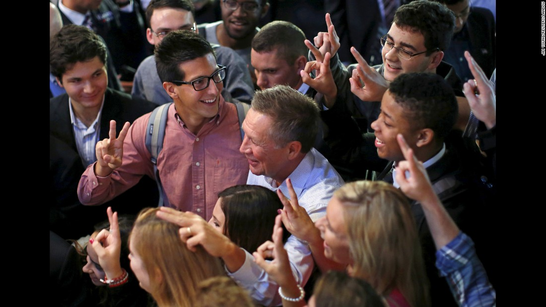 Ohio Gov. John Kasich, who is seeking the Republican Party's presidential nomination, jokes with supporters during a campaign stop in Chicago on Tuesday, September 29.