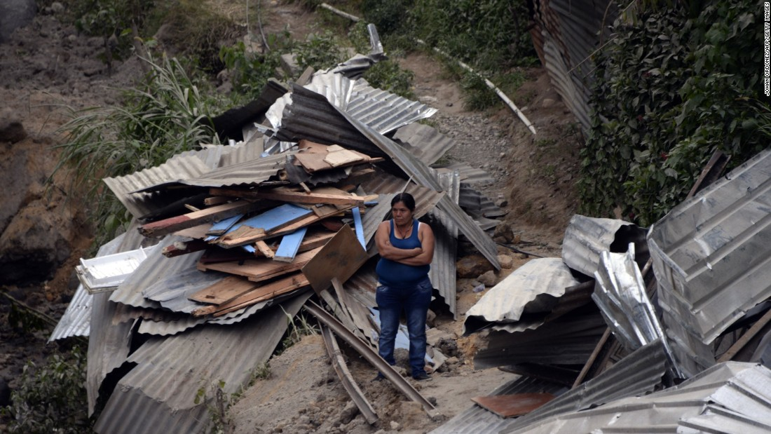 A woman stands in the midst of the debris on October 2.